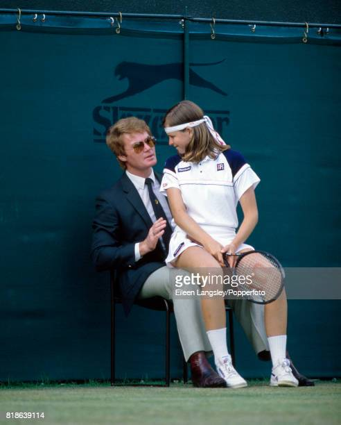 Hana Mandlikova of the Czech Republic sits on the lap of a line judge during the Wimbledon Lawn Tennis Championships in London circa July 1984
