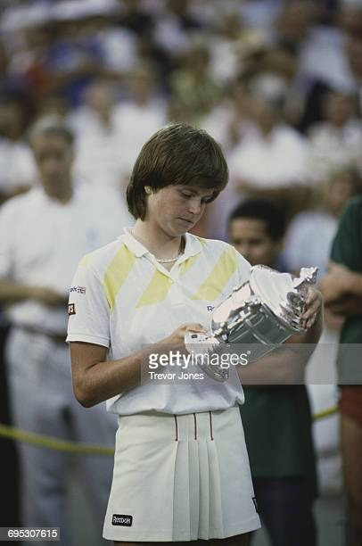 Hana Mandlíková of Czechoslovakia looks down at the trophy after defeating Martina Navratilova to win the Women's Singles Final match of the United...