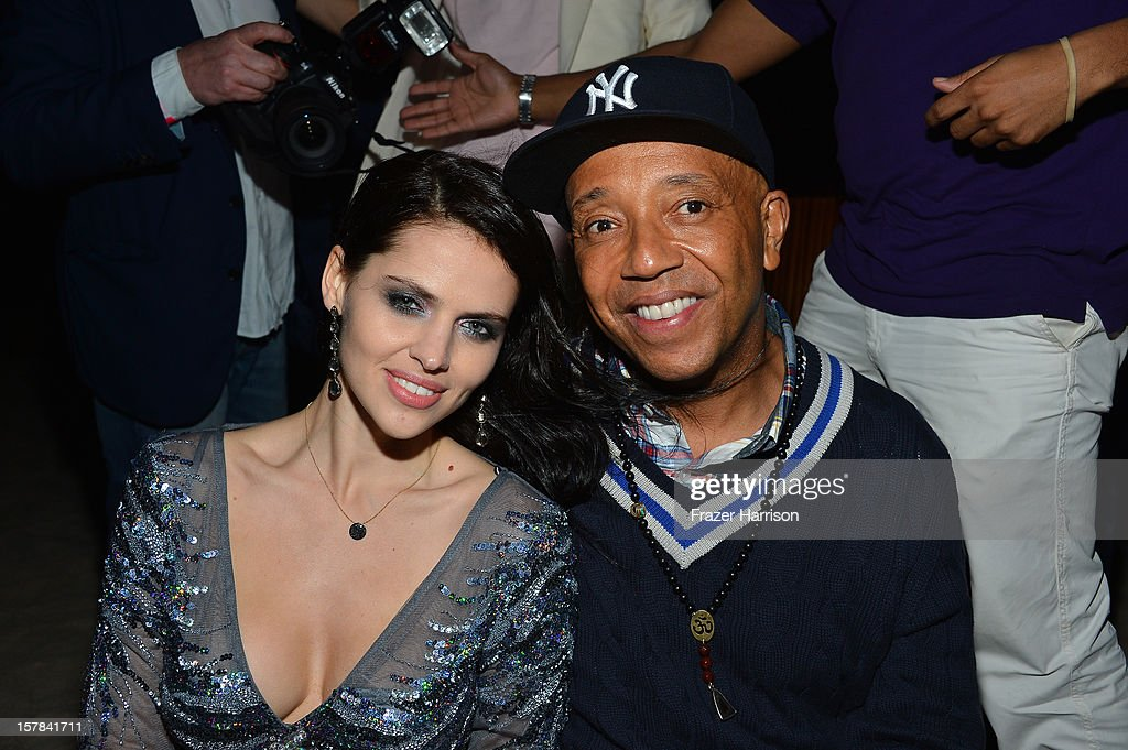Hana Nitsche (L) and Russell Simmons attend the amfAR Inspiration Miami Beach Party on December 6, 2012 in Miami Beach, United States.
