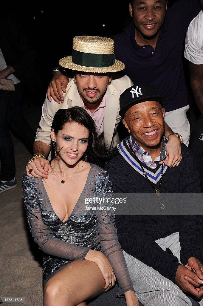 Hana Nitsche, DJ Cassidy and Russell Simmons attend the amfAR Inspiration Miami Beach Party at Soho Beach House on December 6, 2012 in Miami Beach, Florida.