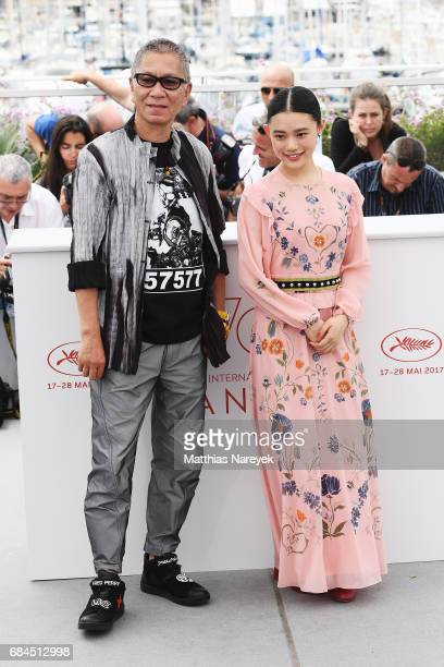 Hana Sugisaki and Takashi Miike attend the 'Blade Of The Immortal ' photocall during the 70th annual Cannes Film Festival at Palais des Festivals on...