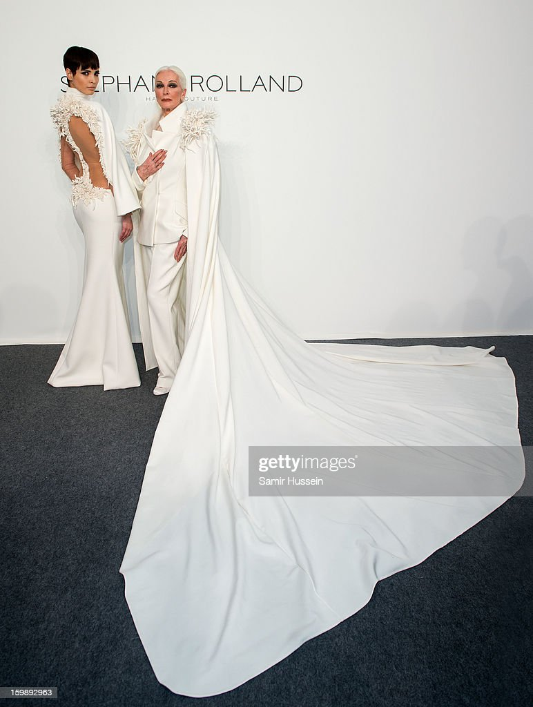 Hanaa Ben Abdesslem and Carmen Dell'Orefice (R) pose backstage at the Stephane Rolland Spring/Summer 2013 Haute-Couture show as part of Paris Fashion Week at Palais De Tokyo on January 22, 2013 in Paris France.
