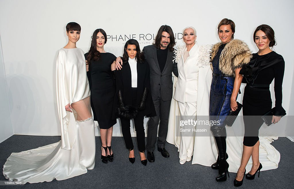 Hanaa Ben Abdesslem, Paz Vega, Kim Kardashian, Stephane Rolland, Carmen Dell'Orefice, Yasmin Le Bon and Sophia Assaidi pose backstage at the Stephane Rolland Spring/Summer 2013 Haute-Couture show as part of Paris Fashion Week at Palais De Tokyo on January 22, 2013 in Paris France.