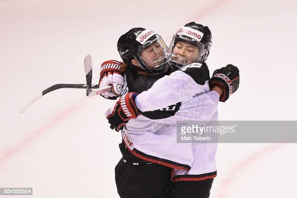 Hanae Kubo of Japan celebrates scoring a goal with Toko Haruka during the Women's Ice Hockey Olympic Qualification Final game between Austria and...