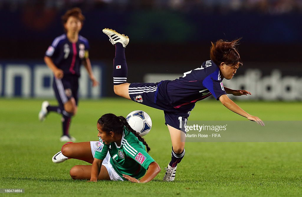 Hanae Shibata (R) of Japan and Ariana Martinez(L) of Mexico battle for the ball during the FIFA U-20 Women's World Cup 2012 group A match between Japan and Mexico at Miyagi Stadium on August 19, 2012 in Rifu, Japan.