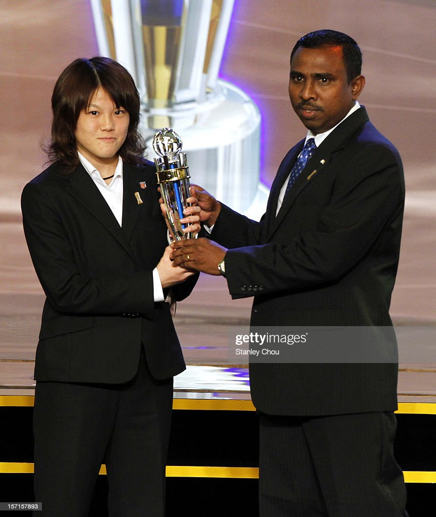Hanae Shibata (L) of Japan receives the 2012 AFC Youth Player of the Year (Women) Award from Ali Azim, AFC Executive Committee member, during The 2012 AFC Annual Awards at the Mandarin Oriental Hotel on November 29, 2012 in Kuala Lumpur, Malaysia.