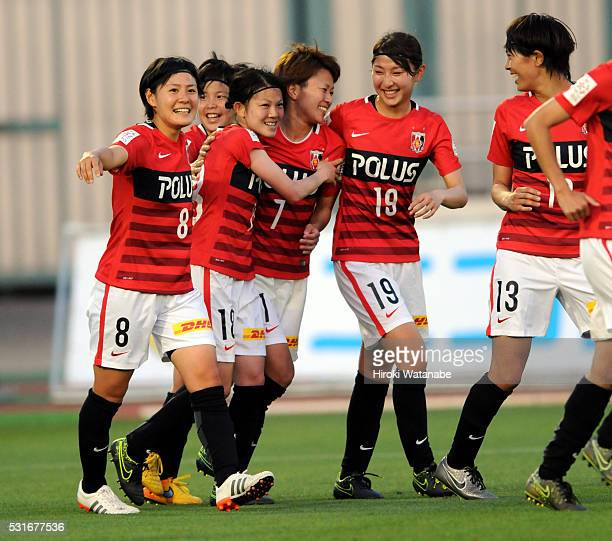 Hanae Shibata of Urawa Red Diamonds celebrates scoring her team's first goal with her team mates during the Nadeshiko League match between Urawa Red...