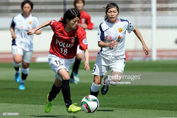 Hanae Shibata of Urawa Reds Ladies and Nahomi Kawasumi of INAC compete for the ball during the Nadeshiko League match between Urawa Red Diamonds and...