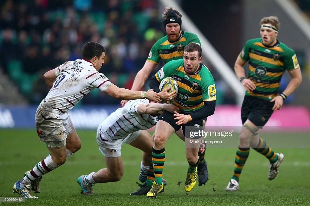 JJ Hanarahan of Northampton charges past Fergus Mulchrone of London Irish during the Aviva Premiership match between Northampton Saints and London Irish at Franklins Gardens on February 13, 2016 in Northampton, England.