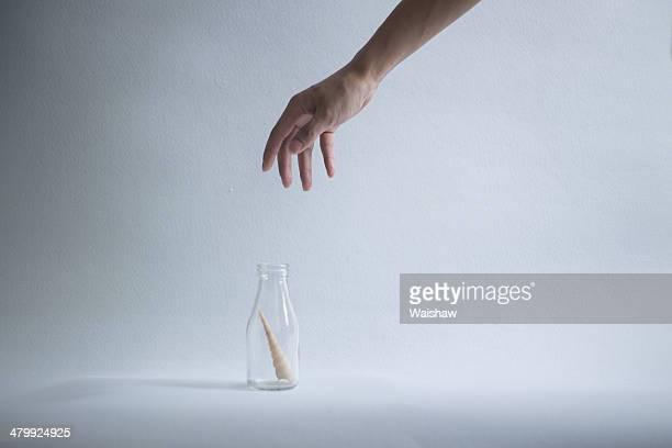 Hand an bottle