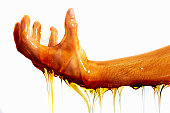 hand and arm covered and dripping with honey