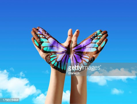 Hand and butterfly : Stock Photo