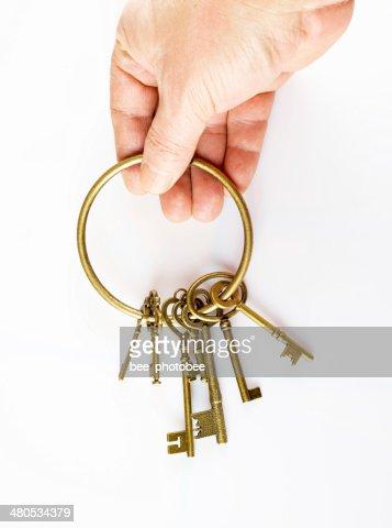 hand and keys : Stockfoto