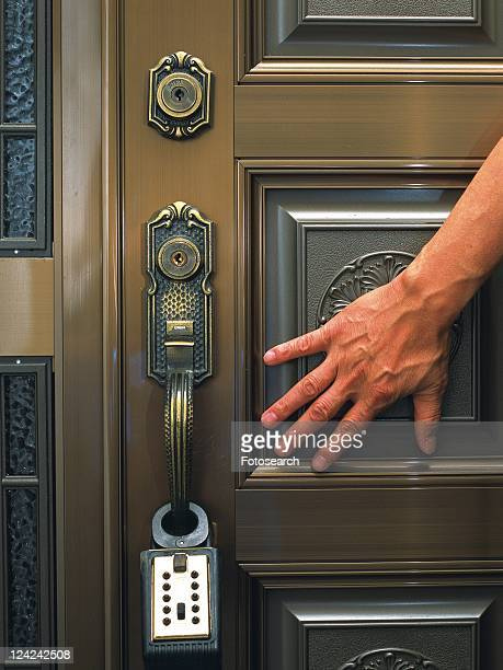 Hand and the door lock, Crime Image, Front View