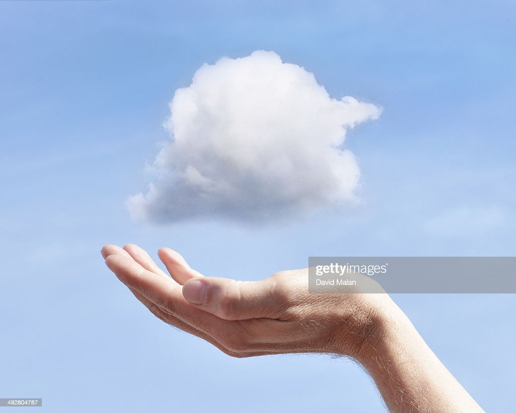 Hand appearing to be holding a cloud