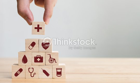 Hand arranging wood block stacking with icon healthcare medical, Insurance for your health concept : Stock Photo