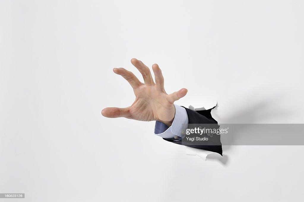 Hand break through the paper : Stock Photo