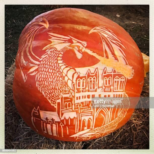 Hand carved dragon jack-o-lantern for Halloween