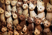 hand carved wooden kitten statues with cute and innocent faces