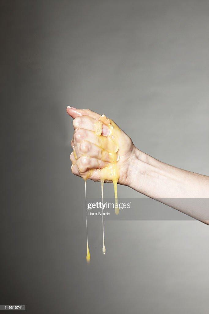 Hand crushing raw egg