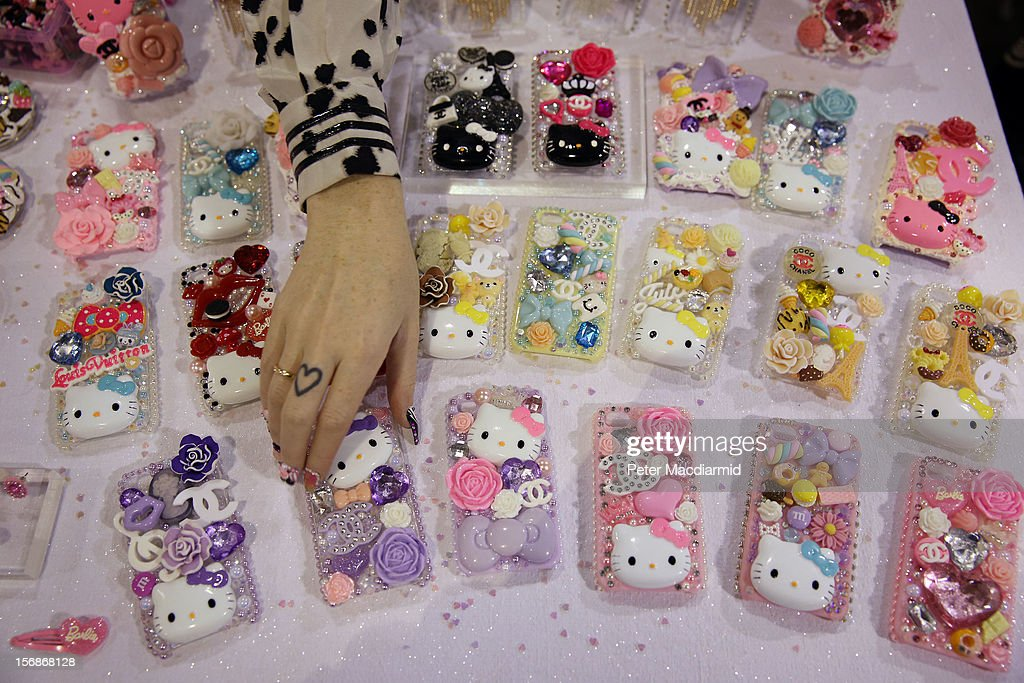 Hand decorated iPhone covers are displayed at The Hyper Japan event at Earls Court on November 23, 2012 in London, England. The show is the UK's biggest Japanese Culture event, with stalls selling clothing and artwork. live music, Japanese food and computer gaming areas are also on show. Many attendees dress up as anime characters or in the lolita fashion widespread in Japan.