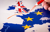 Hand drawing a red line between the UK and the rest of the European Union. Concept of Brexit. The UK is thus on course to leave the EU on 29 March 2019Hand drawing a red line between the UK and the re