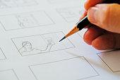 close up hand drawing storyboard