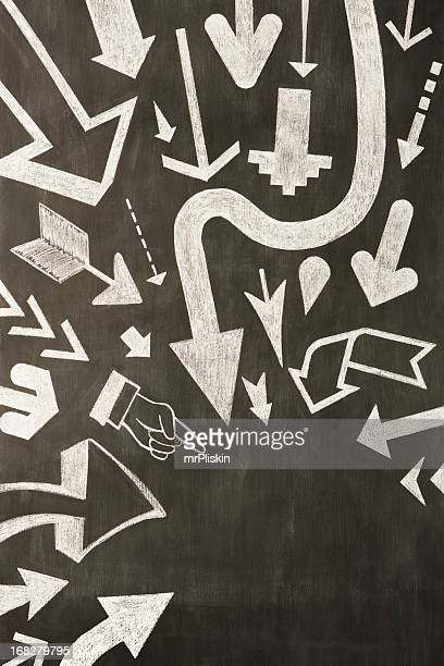 Hand drawn chalk arrows on blackboard