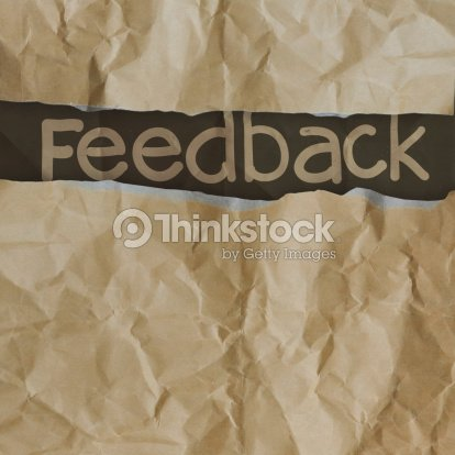 hand drawn feedback  words on crumpled paper with tear envelope : Stock Photo