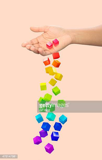 Hand dropping multi coloured blocks