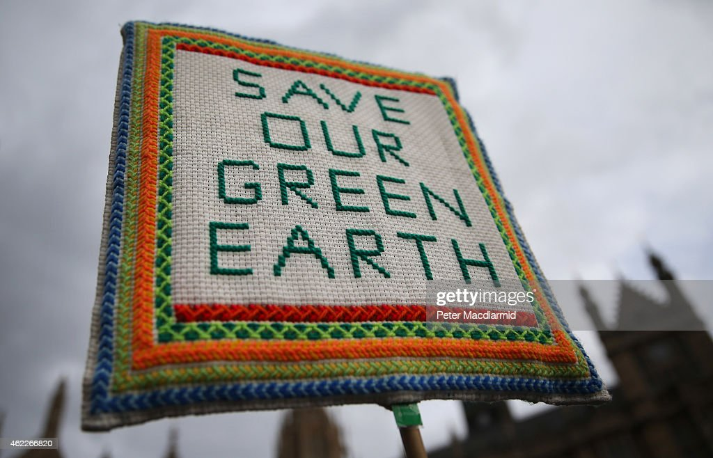 A hand embroidered sign is held aloft at an antifracking protester near Parliament on January 26 2015 in London England protesters plan to lobby...