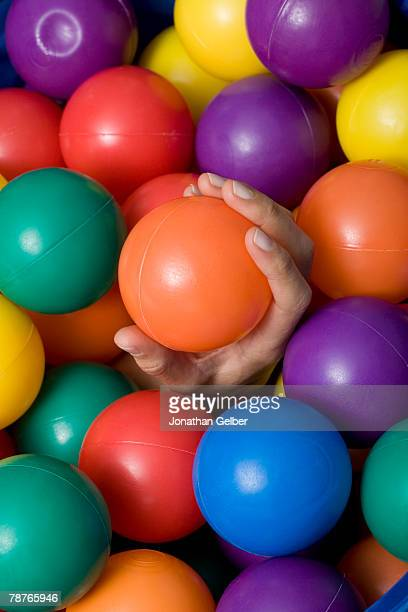 A hand emerging from ball pit