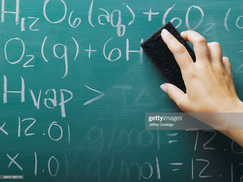 Hand Erasing Equations : Stock Photo