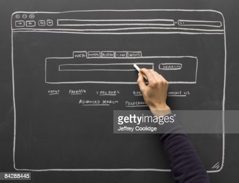 hand filling in diagram of search window : Stockfoto