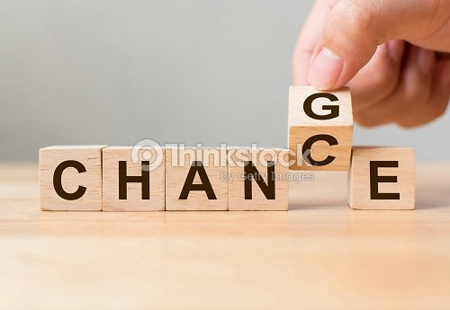 "Hand flip wooden cube with word ""change"" to ""chance"", Personal development and career growth or change yourself concept : Stock Photo"
