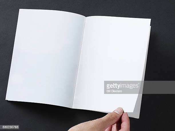 hand flipping blank page
