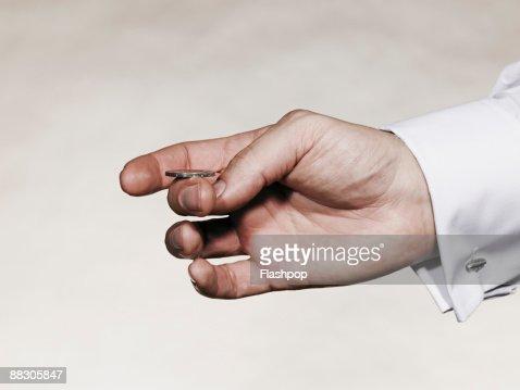 Hand flipping coin : Stockfoto