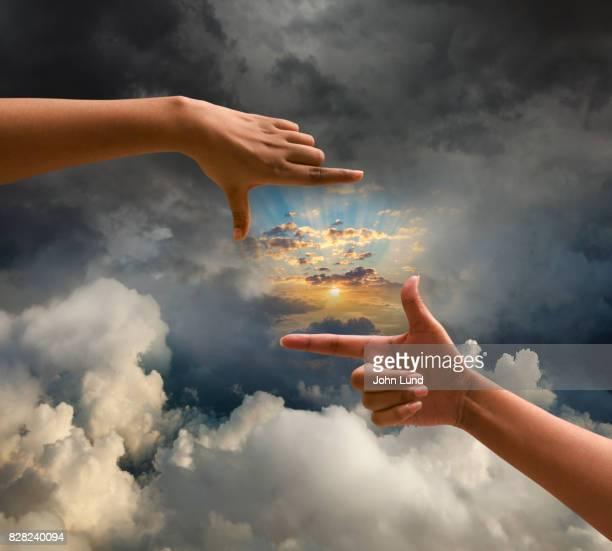 Hand Framing Emerging Sun
