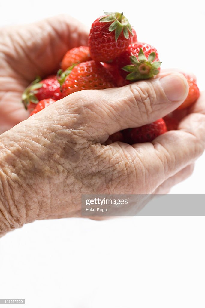 Hand full of strawberry : Stock Photo