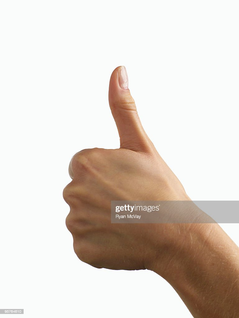 hand giving 'thumbs up' symbol : Stock Photo