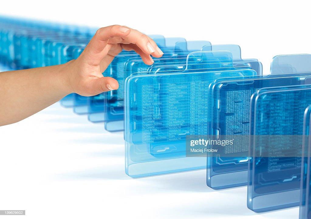 Hand grabbing a virtual folder : Stock Photo
