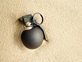 Hand Grenade in Sand