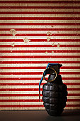 hand grenade on red striped background