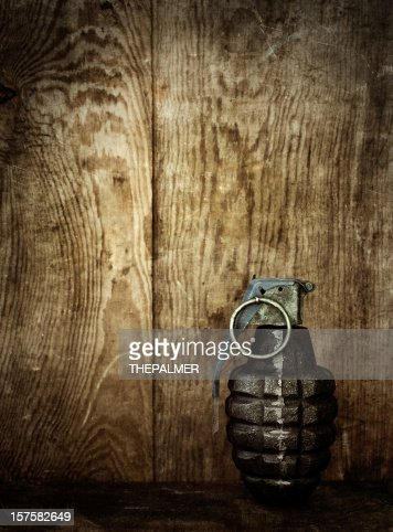hand grenade on wooden background