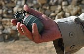 A close up view of an Arges Type HG-84 fragmentation grenade found by US Army (USA) Soldiers assigned to Bravo Company, 3-505th Infantry Battalion, 82nd Airborne Division, during a Sensitive Site Expl