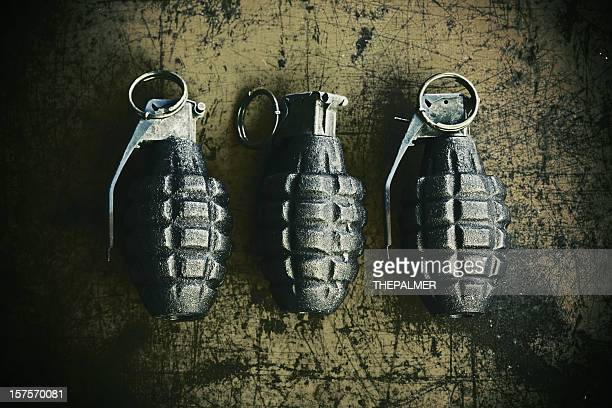 hand grenades on scratchy rusty background