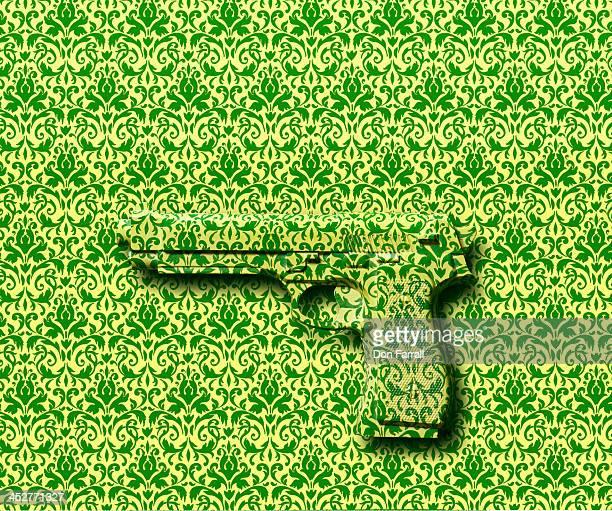 Hand gun fading into a wallpaper background