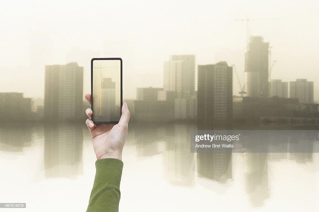 Hand held mobile against city development