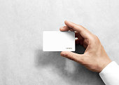 Hand hold blank white loyalty card mockup with rounded corners. Plain vip mock up template holding arm. Plastic discount namecard display front. Gift offset card design. Loyal service branding.