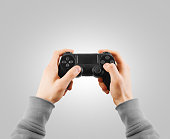 Hand hold new joystick isolated. Gamer play game with gamepad controller.